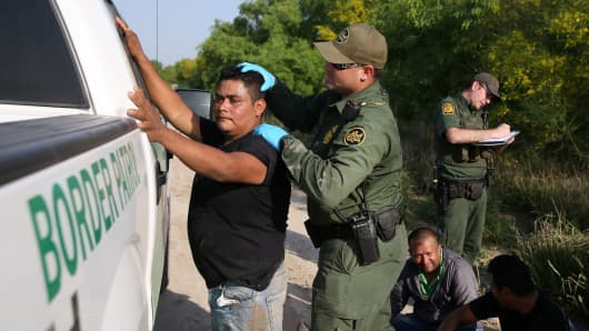 Border patrol agents apprehend immigrants who illegally crossed the border from Mexico into the U.S. in the Rio Grande Valley sector, near McAllen, Texas, April 2, 2018.