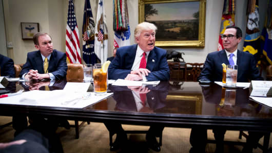 President Donald Trump, with Mick Mulvaney, the director of the Office of Management and Budget, left, and Treasury Secretary Steven Mnuchin, during a working lunch to discuss the federal budget, at the White House in Washington, Feb. 22, 2017.