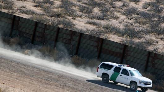 A Border Patrol vehicle drives along the South Texas border.