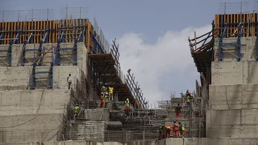 Ethiopian construction workers working on the Grand Renaissance Dam near the Sudanese-Ethiopian border on March 31, 2015.