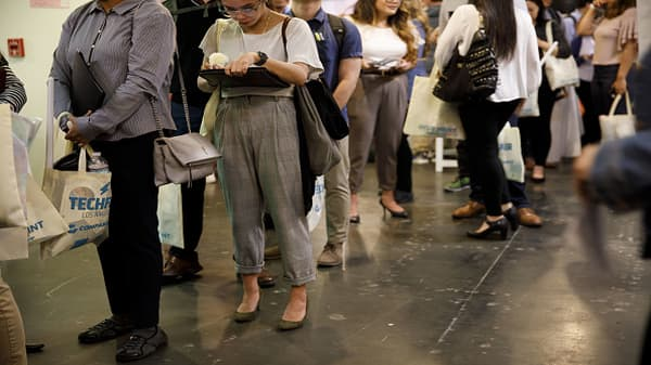 Initial jobless claims up 24,000 to 242,000