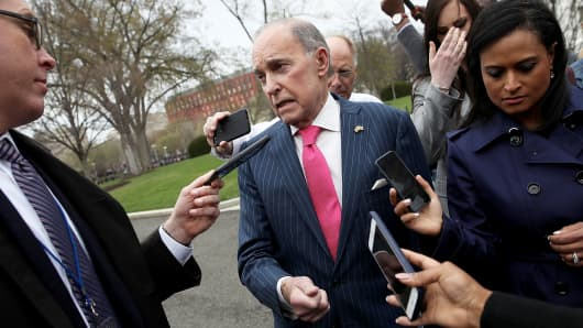 Larry Kudlow (C), Director of the National Economic Council, speaks to reporters outside the White House April 4, 2018 in Washington, DC.