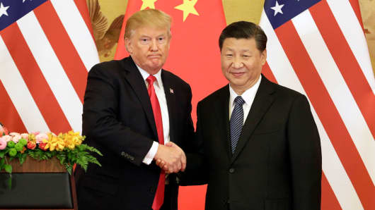 President Donald Trump, left, and Xi Jinping, China's president, shake hands during a news conference at the Great Hall of the People in Beijing, China, on Thursday, Nov. 9, 2017.