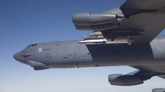 A U.S. Air Force B-52 carries the X-51 Hypersonic Vehicle for a launch test on May 1, 2013.
