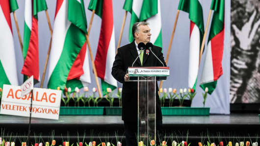 Viktor Orban, Hungary's prime minister, pauses as he delivers a speech during a public ceremony in Budapest, Hungary, on Thursday, March 15, 2018.