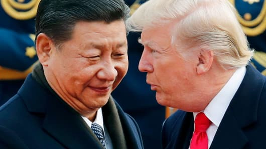 In this Nov. 9, 2017, file photo, U.S. President Donald Trump, right, chats with Chinese President Xi Jinping.  How a trade war with China could hurt the tech industry 105114519 AP 18016719139328