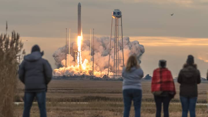 Onlookers watch as Orbital ATK launches its OA-8E resupply mission to the International Space Station on an Antares rocket.