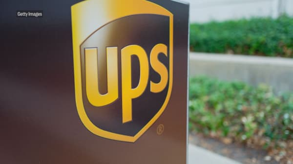 Amazon and UPS have been fighting over the post office's cost structure long before Trump