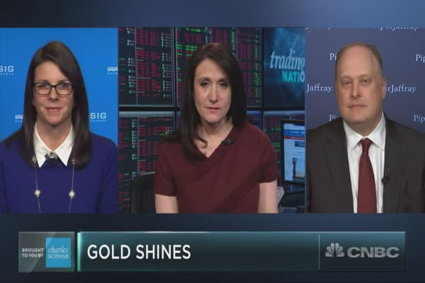 Gold may be having a major moment as volatility slams the market. Here's how to play it