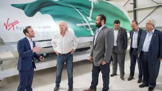 Saudi Crown Prince Mohammad bin Salman at Virgin Galactic with Richard Branson (middle) and an executive.