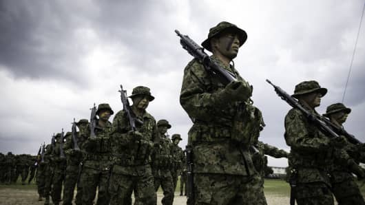 Soldiers of Japanese Ground Self-Defense Force (JGSDF), the brand-new Marinesnamed The Amphibious Rapid Deployment Brigade attend