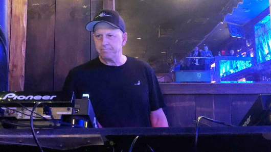 Goldman Sachs Co-President and Co-Chief Operating Officer David Solomon plays disc jockey at a lounge called Libation in New York City, Saturday, April 7, 2018.