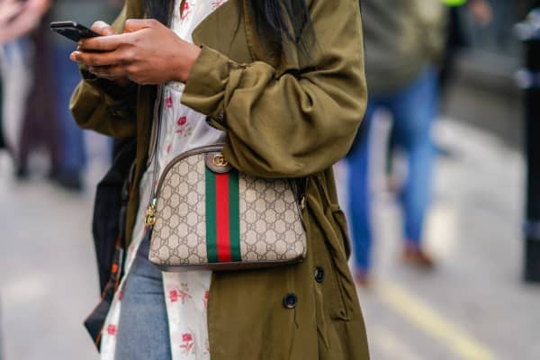 A woman wears a Gucci handbag at London Fashion Week in February 2018