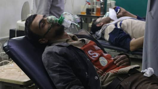 Syrians receive treatment at the field hospital after Assad Regime's alleged chlorine gas attack in Hamouriyah district of Eastern Ghouta in Damascus, Syria on March 6, 2018.
