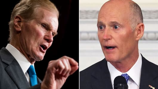 Sen. Bill Nelson, left, and Gov. Rick Scott