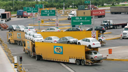 A truck transports new cars at the Port of Veracruz, Mexico.
