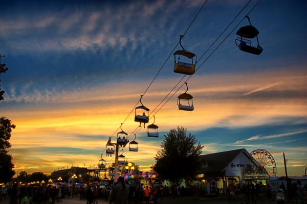 Skylift riders going into the sunset at the Iowa State Fair in Des Moines, IA.