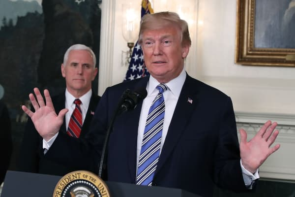 President Donald Trump speaks to the press with Vice President Mike Pence (L), in the Diplomatic Room of the White House on March 23, 2018 in Washington, DC.