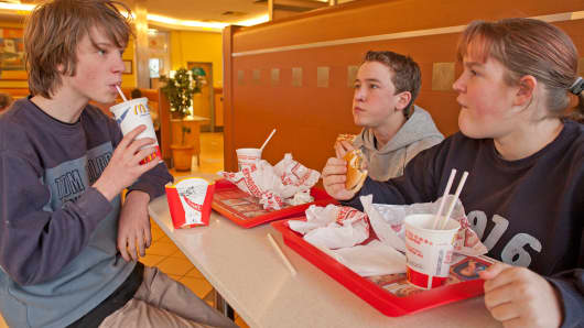 Teenagers eating at McDonalds.