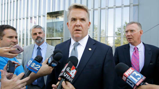 U.S. Attorney John Huber, center, speaks with reporters after leaving the federal courthouse Friday, July 29, 2016, in Salt Lake City, Utah.