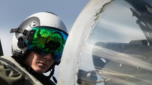 Lt. Emily R. King checks the controls of a Boeing EA-18G Growler on the deck of the USS George H.W. Bush aircraft carrier. The carrier conducted strikes from the eastern Mediterranean in February 2017.