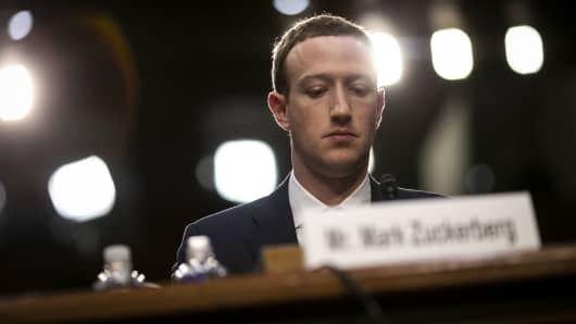 Mark Zuckerberg, chief executive officer and founder of Facebook Inc., listens during a joint hearing of the Senate Judiciary and Commerce Committees in Washington, D.C., U.S., on Tuesday, April 10, 2018.