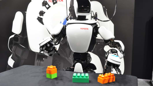 Toyota's T-HR3 humanoid robot and master-slave control device allows operators to control the robot's entire body.