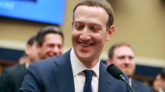 Facebook co-founder and CEO Mark Zuckerberg smiles at the conclusion of his testimony before the House Energy and Commerce Committee in the Rayburn House Office Building on Capitol Hill April 11, 2018, in Washington, DC.