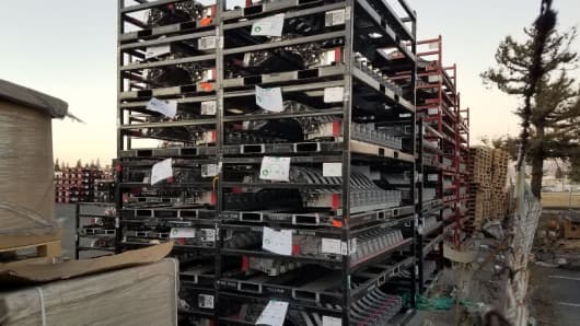 Racks of Tesla parts awaiting rework or shipment at JL Precision in San Jose, California.