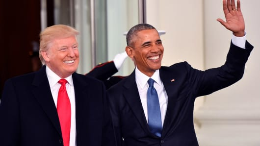 President Barak Obama (R) and President-elect Donald Trump smile at the White House before the inauguration on January 20, 2017