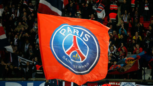 Paris Saint-Germain's supporters wave flags during the French Cup round of 16 football match between Paris Saint-Germain (PSG) and Guingamp (EAG) at the Parc des Princes stadium in Paris on January 24, 2018.