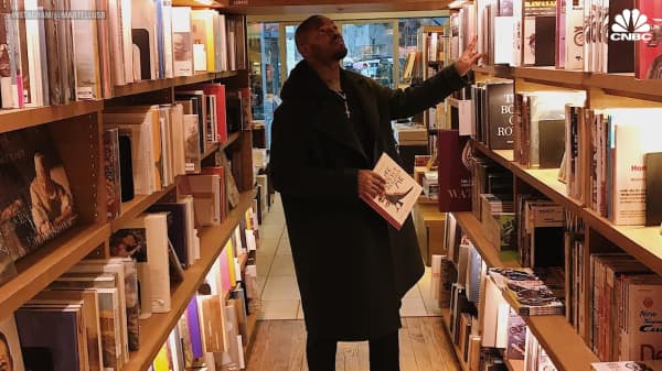 Ex NFL player Martellus Bennett says his biggest splurge is books — and he has 3,500 of them