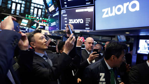 Founder and CEO of Zuora, Tien Tzuo, takes part in the company's IPO on the floor of the New York Stock Exchange shortly after the opening bell in New York, U.S., April 12, 2018.