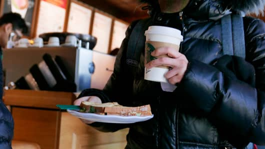Customers in a Starbucks coffee shop.