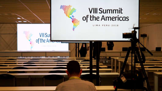A journalist working at the international press center of the VIII Summit of the Americas in Lima, Peru.