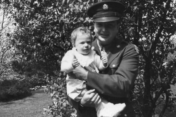 David Rockefeller holding David Rockefeller Jr., circa 1942