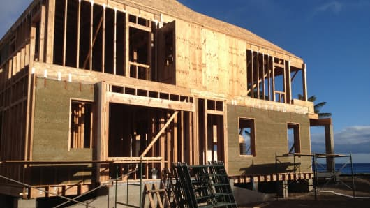 Beachfront house on Maui under construction, with first-floor walls made of hempcrete panels.