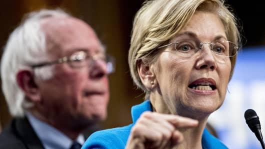 Senator Elizabeth Warren speaks as Senator Bernie Sanders looks on last September.