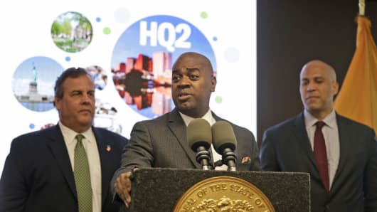 Newark, New Jersey. Mayor Ras Baraka flanked by former New Jersey Gov. Chris Christie (left) and , Senator Cory Booker at an HQ2 event in Newark, New Jersey, on Oct. 16, 2017.
