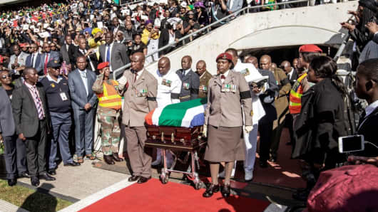 South African military personnel bring in the coffin of Winnie Madikizela-Mandela at Orlando Stadium for the funeral ceremony in Soweto, South Africa, April 14, 2018.