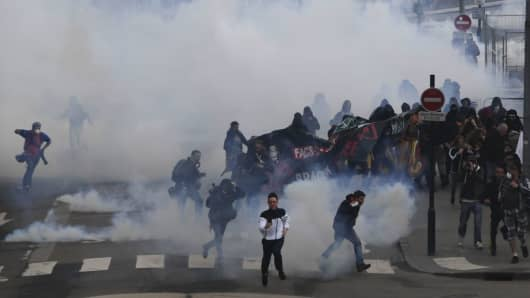 Police use water cannons and tear gas to clear protesters during a demonstration in support of the Notre-Dame-des-Landes ZAD (Zone a Defendre - Zone to defend) anti-airport camp on April 14, 2018, in Nantes, western France.