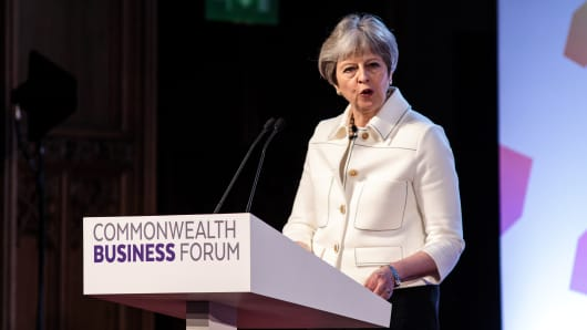 British Prime Minister Theresa May speaks at the Business Forum Opening Session on the first day of the Commonwealth Heads of Government Meeting 2018