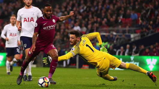 Raheem Sterling of Manchester City in action with Hugo Lloris of Tottenham Hotspur during the Premier League match.
