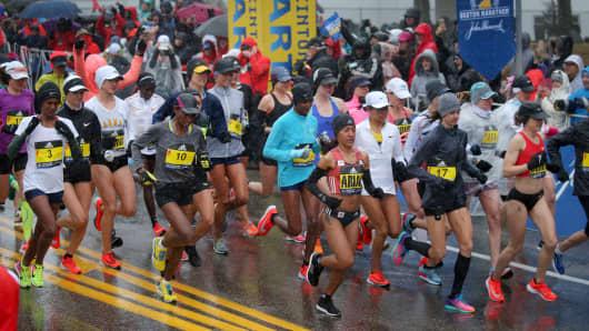 The women's elite runners start the Boston Marathon starting line in Hopkinton, MA on April 16, 2018.