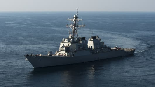 The Arleigh Burke-class guided missile destroyer USS Higgins steams through the Arabian Gulf during a maritime exercise.