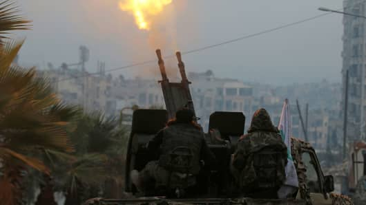 Free Syrian Army fighters fire an anti-aircraft weapon in a rebel-held area of Aleppo, Syria December 12, 2016.