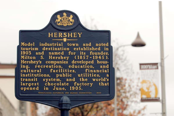 An historic marker stands outside the original Hershey Co. chocolate manufacturing plant in Hershey, Pennsylvania.