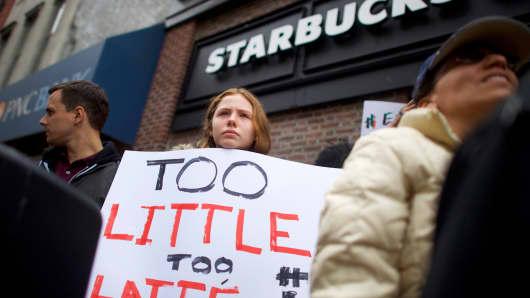 Protestors demonstrate outside a Center City Starbucks on April 15, 2018 in Philadelphia, Pennsylvania.