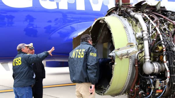 U.S. NTSB investigators are on scene examining damage to the engine of the Southwest Airlines plane in this image released from Philadelphia, Pennsylvania, U.S., April 17, 2018.