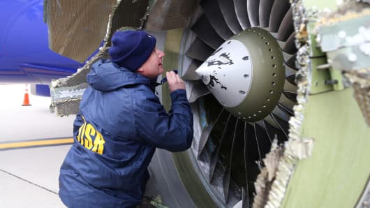A U.S. NTSB investigator is on scene examining damage to the engine of the Southwest Airlines plane in this image released from Philadelphia, Pennsylvania, U.S., April 17, 2018.